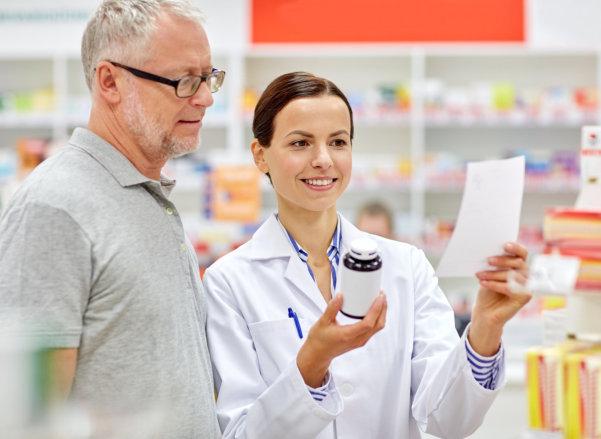 pharmacist with elder man