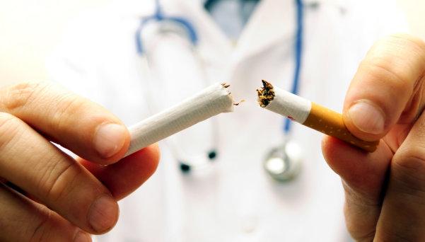 male hand crushing cigarette